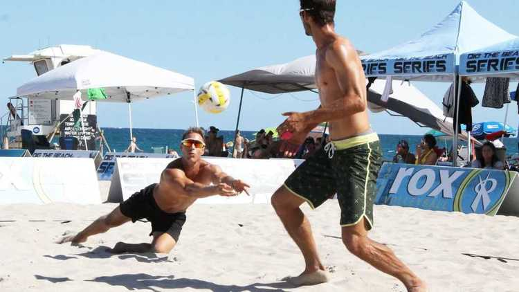 Beach volleyball players diggin' the sand and surf in Pompano series